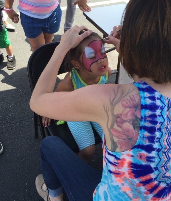 Photo: Child getting face painted