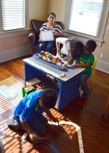 Photo: Children Playing with Train Sets