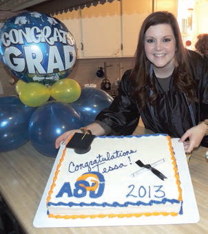 Photo: Tessa at Graduation Ceremony with a Cake