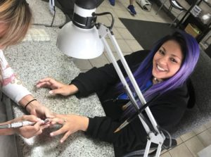 Photo: Girl getting her nails Done